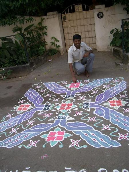 Peacock kolam rangoli design in chalk
