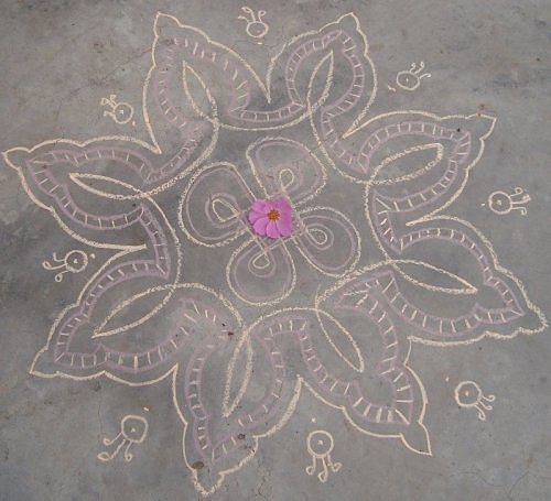 Daily kolam rangoli design in chalk